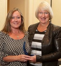 Pat Vos Receiving Award (with Linda Osip) at 2013 CAM-X Convention