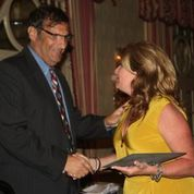 Michael Leibowitz receiving award from Sydney Ryan at 2013 CAM-X Convention